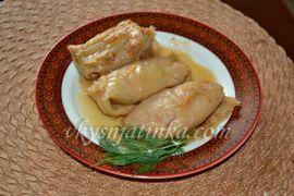 Вкусные голубцы из капусты с фаршем и рисом - фото
