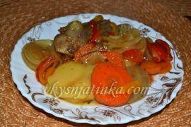 Свиные ребрышки с овощами в духовке