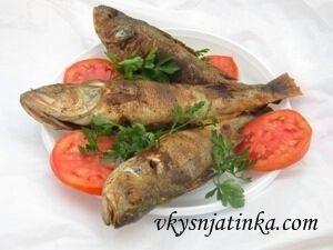 Рыба на костре - фото